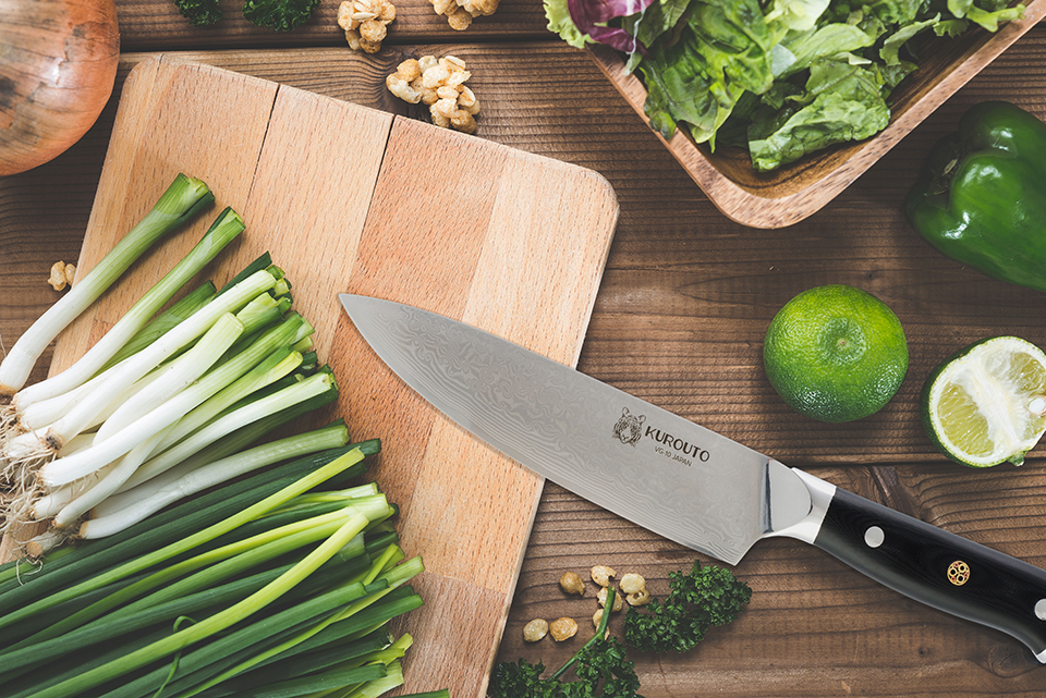 Kurouto Kitchenware Chef's Knife Kitchen Flatlay with Green Onions and Limes